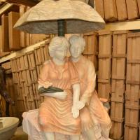 Quality Young Couple Under Umbrella Statue Marble Stone Garden Water Fountain for sale