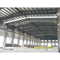 China steel structure frame workshop warehouse and sandwich panel wall roof and roller shutter door on sale