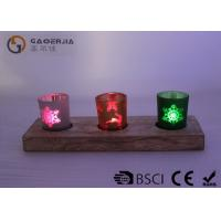 Buy glass candle holder with laser picture with wooden base and LED tealight at wholesale prices
