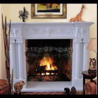 Quality Electric marble fireplace mantel surrounds with stone figure carvings,China marble fireplace supplier for sale