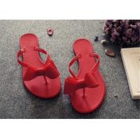 China Plastic Upper Fashion Flip Flops With Bowknot Flat Heel Ladies Thong Slippers on sale